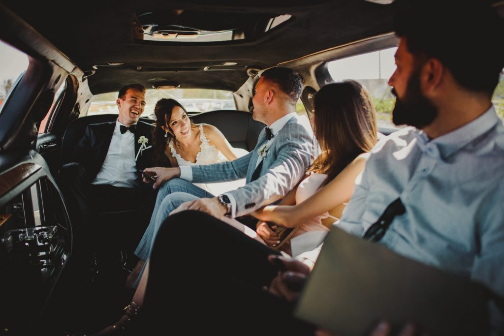 wedding party having fun in limo
