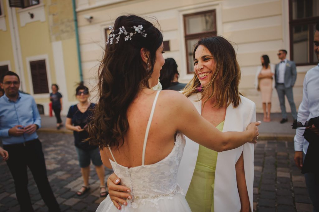 bride and friend hugging