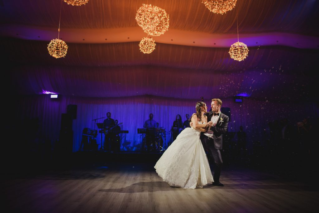 bride and groom first dance at riverside golf
