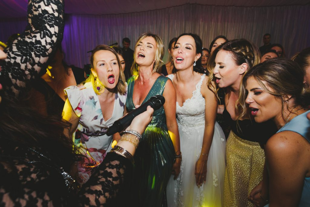 bridesmaids and bride singing