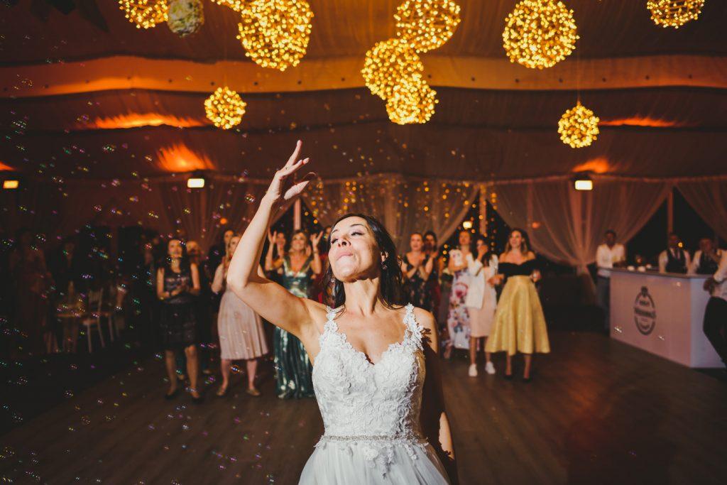 bride tossing buquette