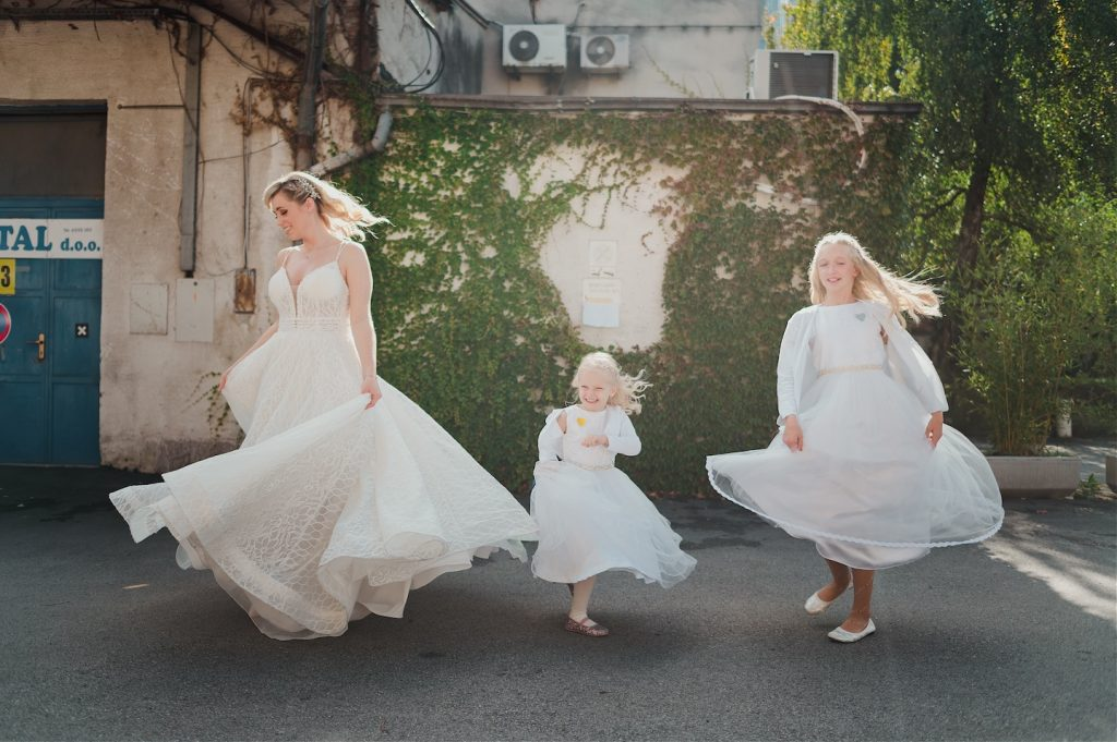bride and her nieces spinning their dresses