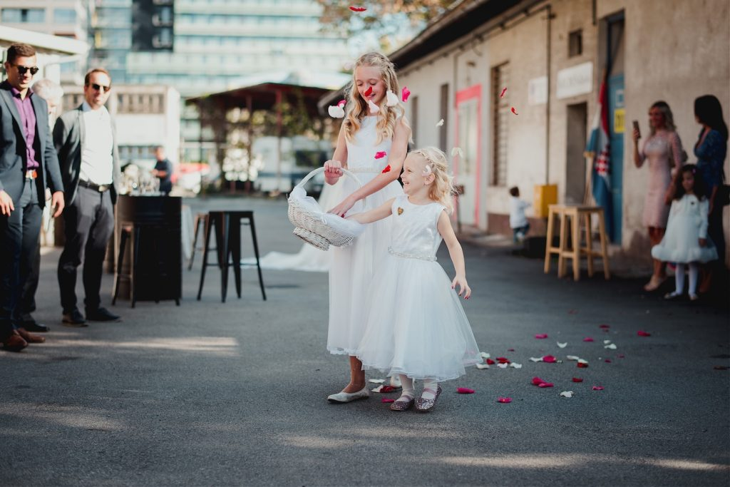 nieces tossing flower petals in front of bride before ceremony in katran studio zagreb