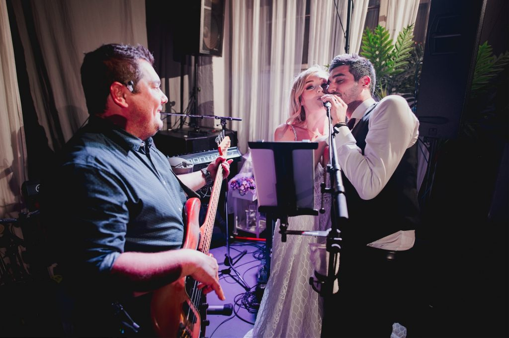 wild party at wedding in studio katran zagreb. bride and groom singing with the band