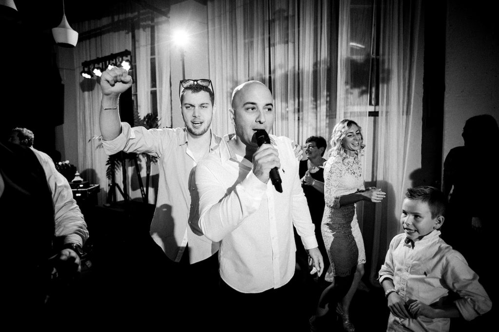 wild party at wedding in studio katran zagreb. groom step brother singing with the band