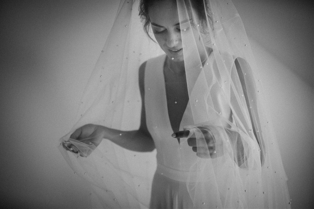 bride playing with her veil