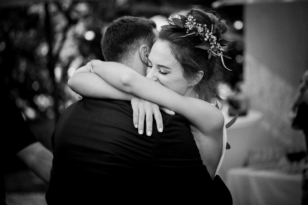 bride hugging groom and crying after seeing him