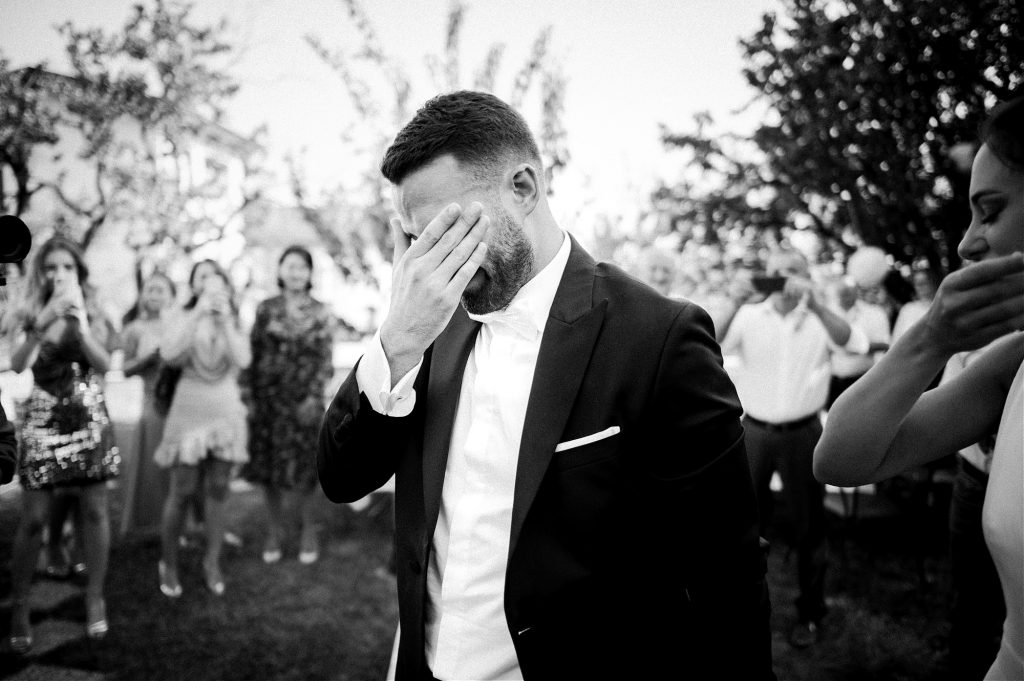 groom crying after seeing his bride for the first time