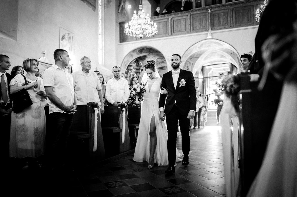bride and groom walking down the aisle in Remete church