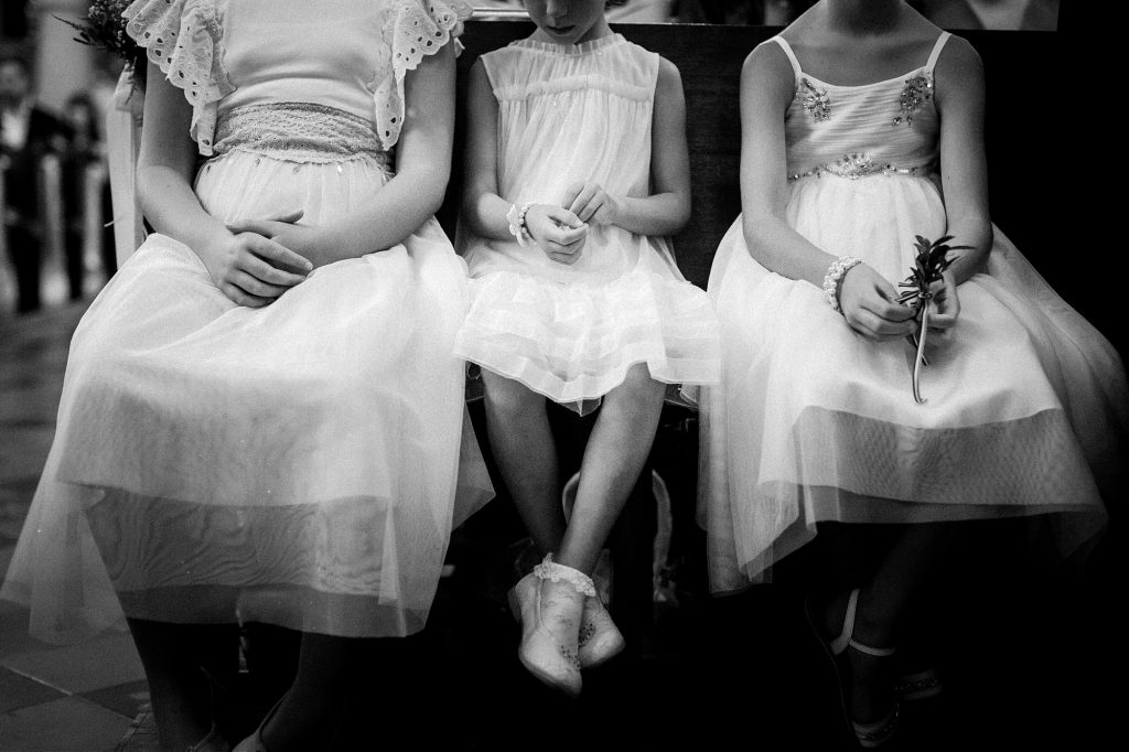 bridesmaids playing with their fingers during ceremony in Zagreb