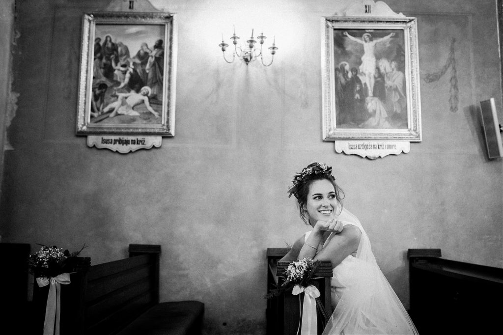 bride taking a moment in the church after the ceremony in Remete, Zagreb