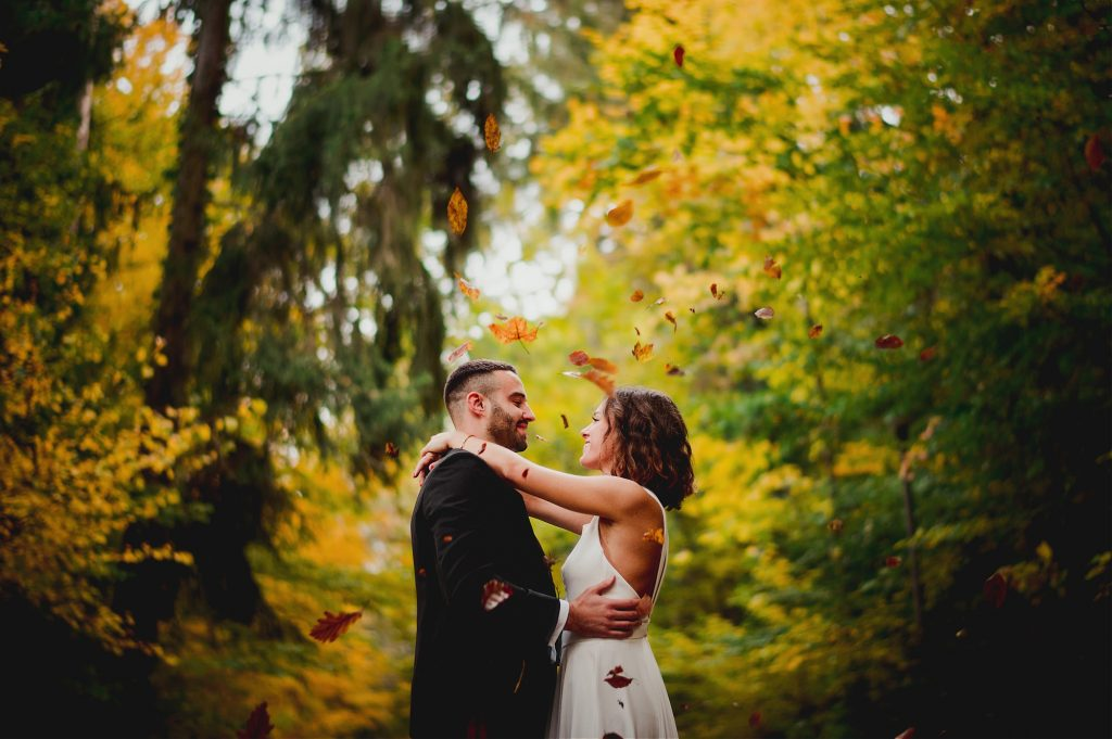 leaves falling around bride and groom