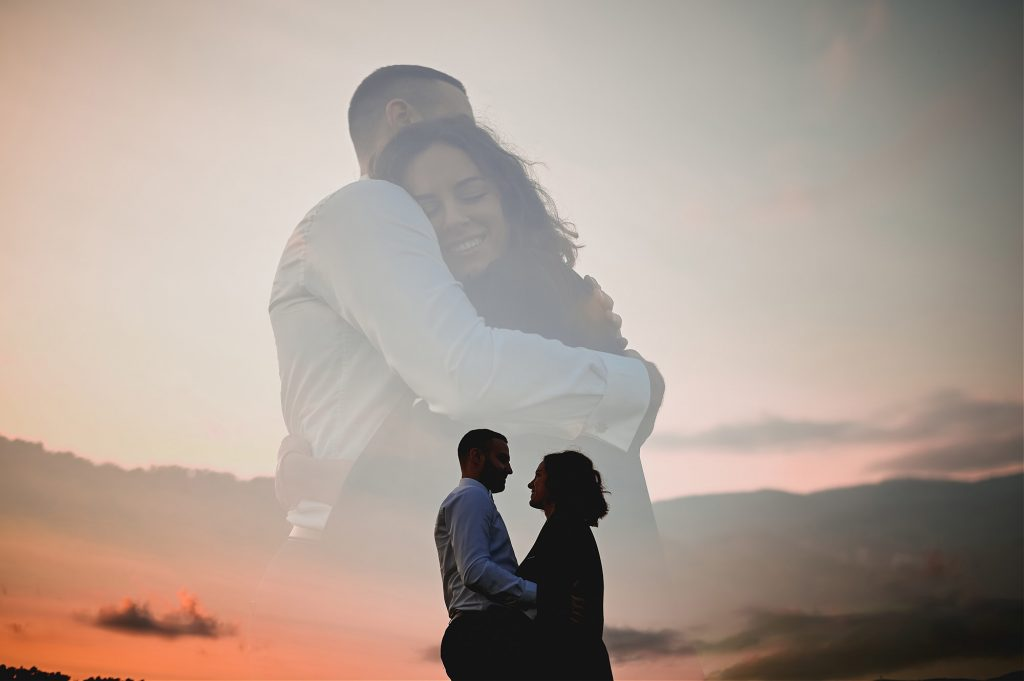 multiple exposure of bride and groom hugging in a sunset